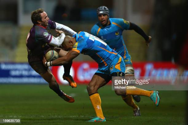 Will Harries of Newport Gwent Dragons holds onto Tom Varndell of London Wasps during the Amlin Challenge Cup Pool Three match between Newport Gwent...
