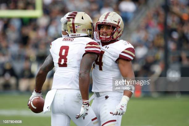 Will Harris of the Boston College Eagles celebrates with Max Richardson after recovering a fumble in the fourth quarter of the game against the...