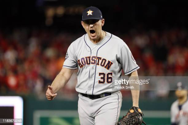 Will Harris of the Houston Astros celebrates after retiring the side in the sixth inning against the Washington Nationals in Game Four of the 2019...