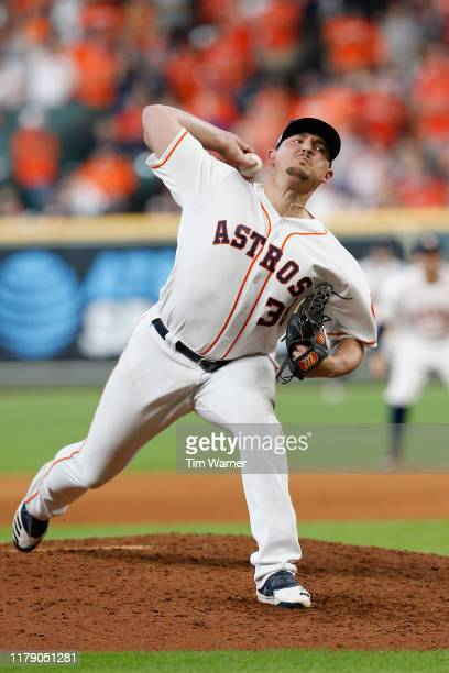 Will Harris of the Houston Astros delivers a pitch in the eighth inning against the Tampa Bay Rays in game one of the American League Division Series...