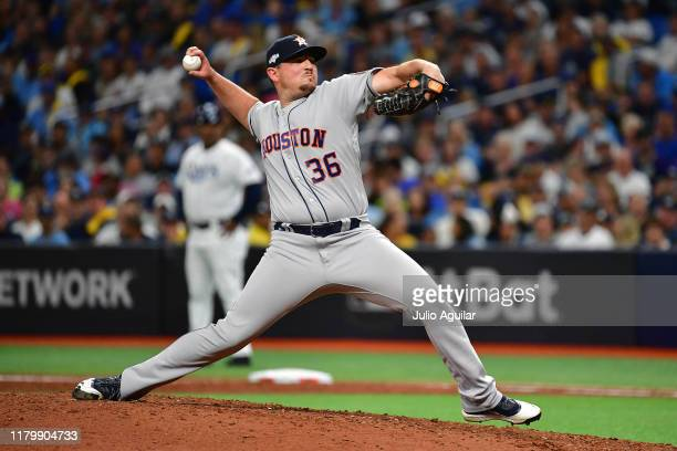 Will Harris of the Houston Astros delivers the pitch against the Tampa Bay Rays during the eighth inning in game four of the American League Division...