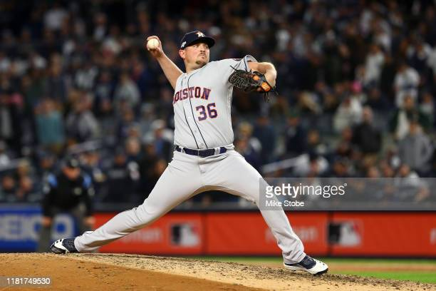 Will Harris of the Houston Astros delivers the pitch against the New York Yankees during the seventh inning in game four of the American League...