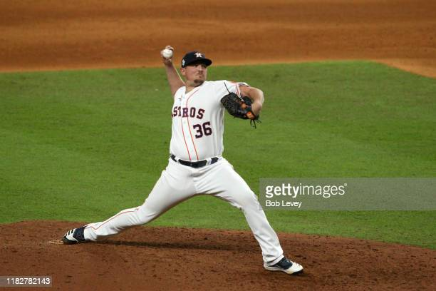 Will Harris of the Houston Astros delivers the pitch against the Washington Nationals during the eighth inning in Game One of the 2019 World Series...