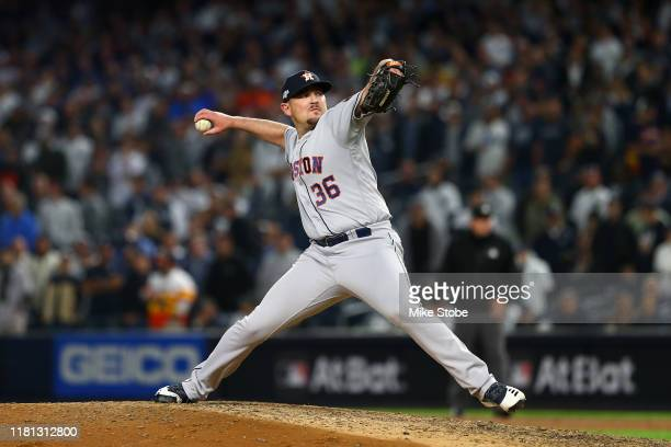 Will Harris of the Houston Astros pitches during the eighth inning against the New York Yankees in game three of the American League Championship...