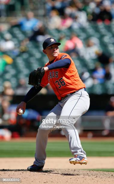Will Harris of the Houston Astros pitches during the game against the Oakland Athletics at the Oakland Alameda Coliseum on May 9 2018 in Oakland...