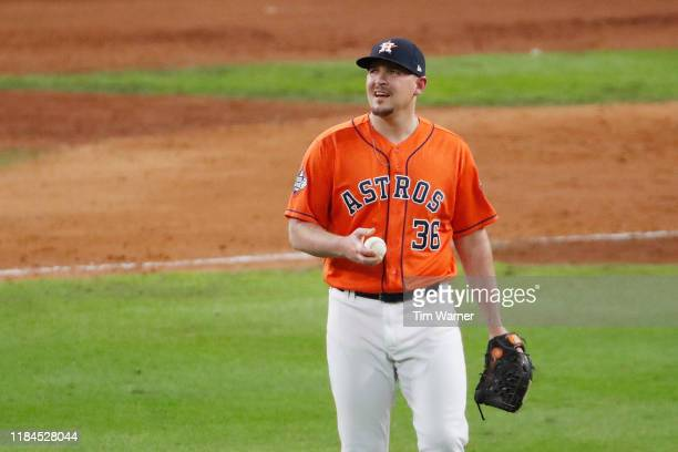 Will Harris of the Houston Astros reacts after allowing a tworun home run to Howie Kendrick of the Washington Nationals during the seventh inning in...