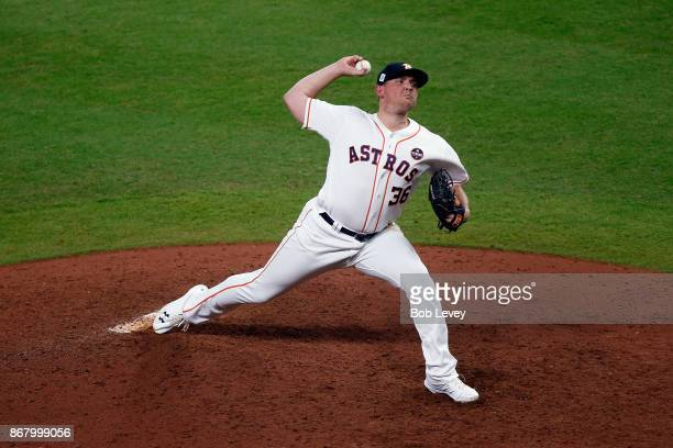 Will Harris of the Houston Astros throws a pitch during the eighth inning against the Los Angeles Dodgers in game five of the 2017 World Series at...