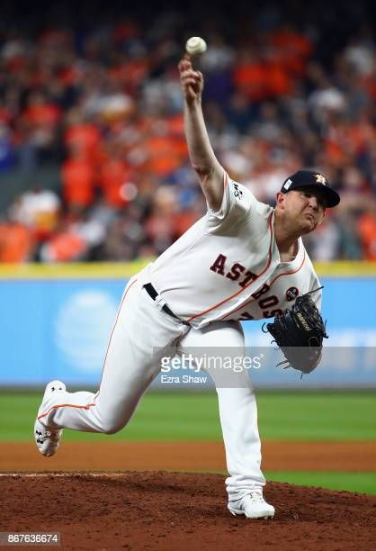 Will Harris of the Houston Astros throws a pitch during the seventh inning against the Los Angeles Dodgers in game four of the 2017 World Series at...