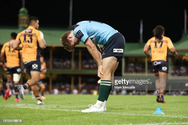 Will Harrison of the Waratahs looks dejected after missing a conversion to draw the round 7 Super RugbyAU match between the NSW Waratahs and the ATC...