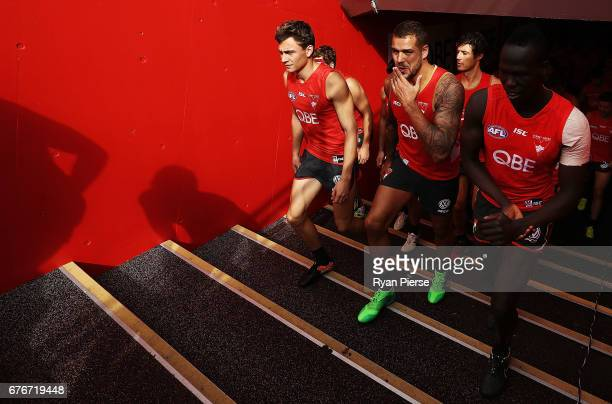 Will Hayward Lance Franklin and Aliir Aliir of the Swans prepare to train during a Sydney Swans AFL training session at Sydney Cricket Ground on May...