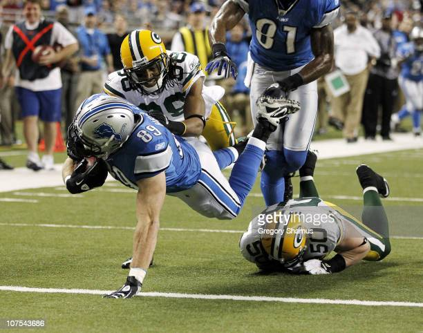 Will Heller of the Detroit Lions gets between AJ Hawk and Tramon Williams of the Green Bay Packers for a fourth quarter touchdown on December 12 2010...