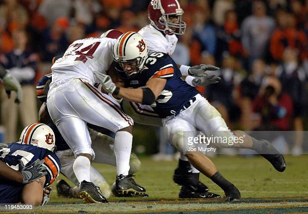 Will Herring tackles Kenneth Darby during second half action The Auburn Tigers beat the Alabama Crimson Tide 2818 on November 19 2005 at JordanHare...
