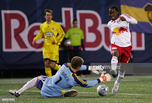 Will Hesmer of the Columbus Crew tries to stop Oscar Echeverry of the New York Red Bulls at Giants Stadium in the Meadowlands on April 5 2008 in East...