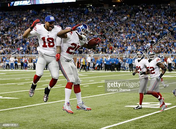 Will Hill of the New York Giants celebrates his fourth quarter interception for a touchdown with Louis Murphy while playing the Detroit Lions at Ford...