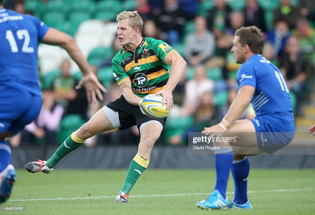 Will Hooley, of Northampton passes the ball during the pre season friendly match between Northampton Saints and Leinster at Franklin's Gardens on August 23, 2014 in Northampton, England.