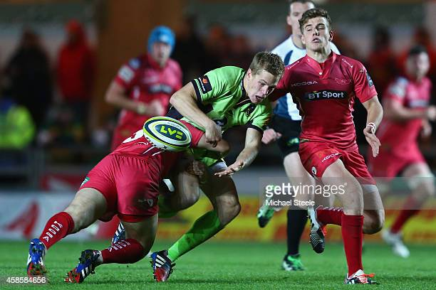 Will Hooley of Northampton Saints loses the ball as Steffan Evans of Scarlets tackles during the LV=Cup match between Scarlets and Northampton Saints...