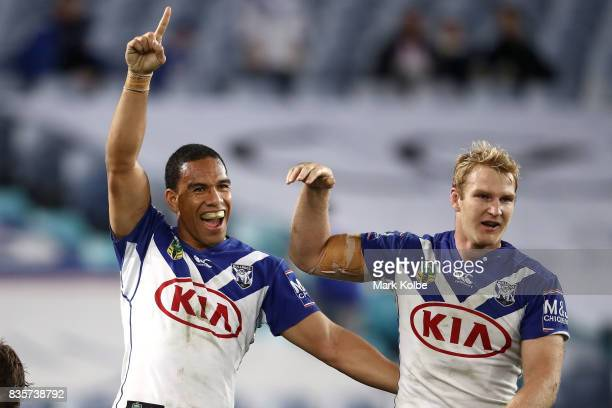 Will Hopoate and Aiden Tolman of the Bulldogs celebrate Brett Morris scoring a try during the round 24 NRL match between the Canterbury Bulldogs and...