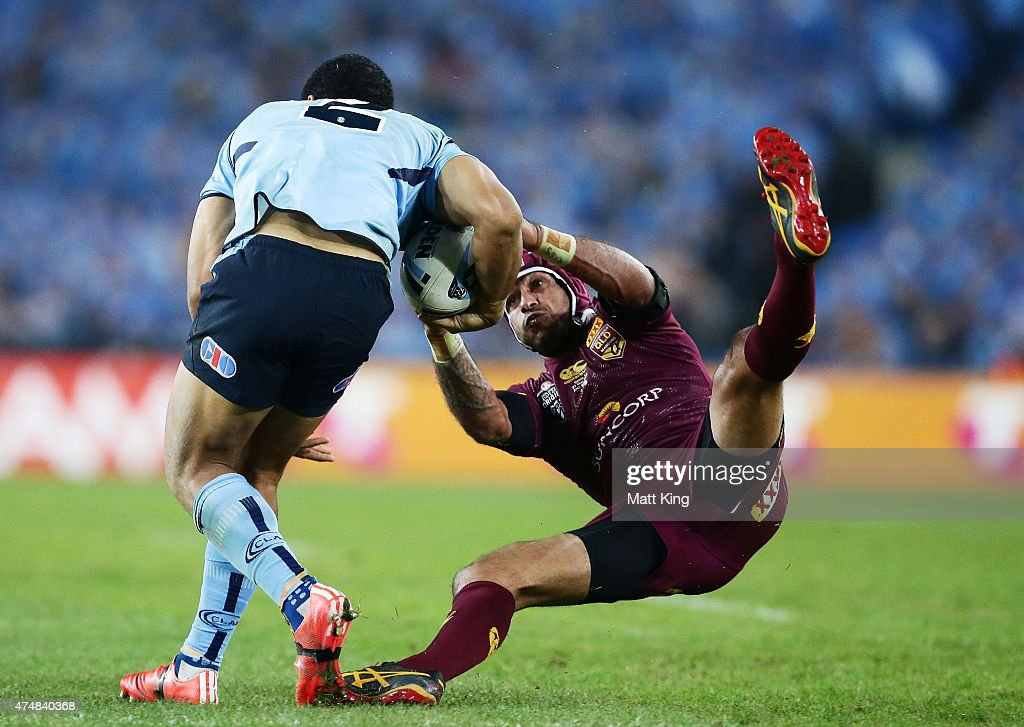 Will Hopoate of the Blues is tackled by Johnathan Thurston of the Maroons during game one of the State of Origin series between the New South Wales Blues and the Queensland Maroons at ANZ Stadium on May 27, 2015 in Sydney, Australia.