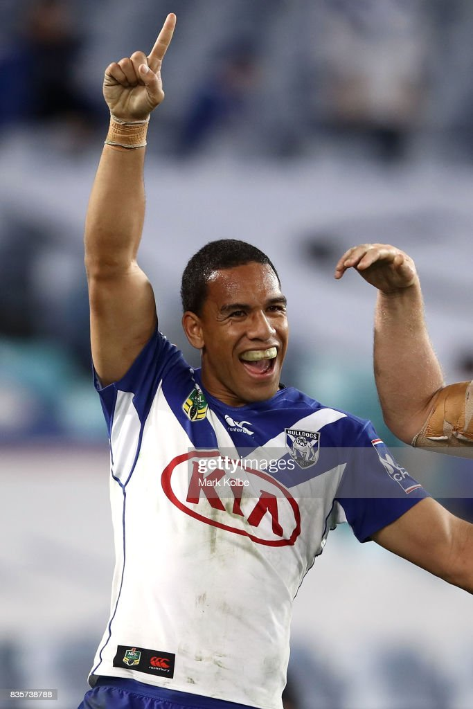 Will Hopoate of the Bulldogs celebrates Brett Morris scoring a try during the round 24 NRL match between the Canterbury Bulldogs and the Manly Sea Eagles at ANZ Stadium on August 20, 2017 in Sydney, Australia.