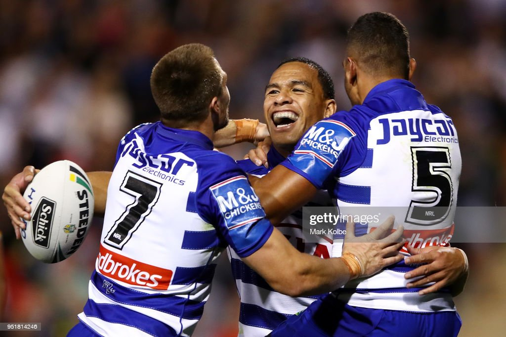 Will Hopoate of the Bulldogs celebrates scoring a try with team mates during the NRL round eight match between the Penrith Panthers and Canterbury Bulldogs on April 27, 2018 in Penrith, Australia.