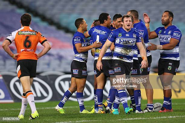 Will Hopoate of the Bulldogs celebrates with teammates after scoring a try during the round 18 NRL match between the Canterbury Bulldogs and the...