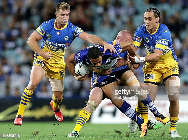 Will Hopoate of the Bulldogs is tackled by Beau Scott of the Eels during the round three NRL match between the Canterbury Bulldogs and the Parramatta...