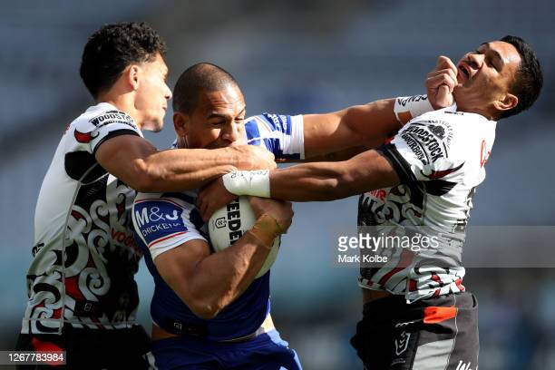 Will Hopoate of the Bulldogs is tackled by Hayze Perham and Paul Turner of the Warriors during the round 15 NRL match between the Canterbury Bulldogs...