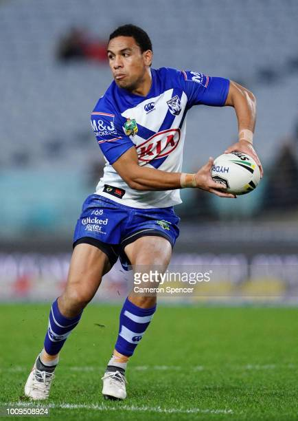 Will Hopoate of the Bulldogs passes during the round 21 NRL match between the Canterbury Bulldogs and the Brisbane Broncos at ANZ Stadium on August 2...