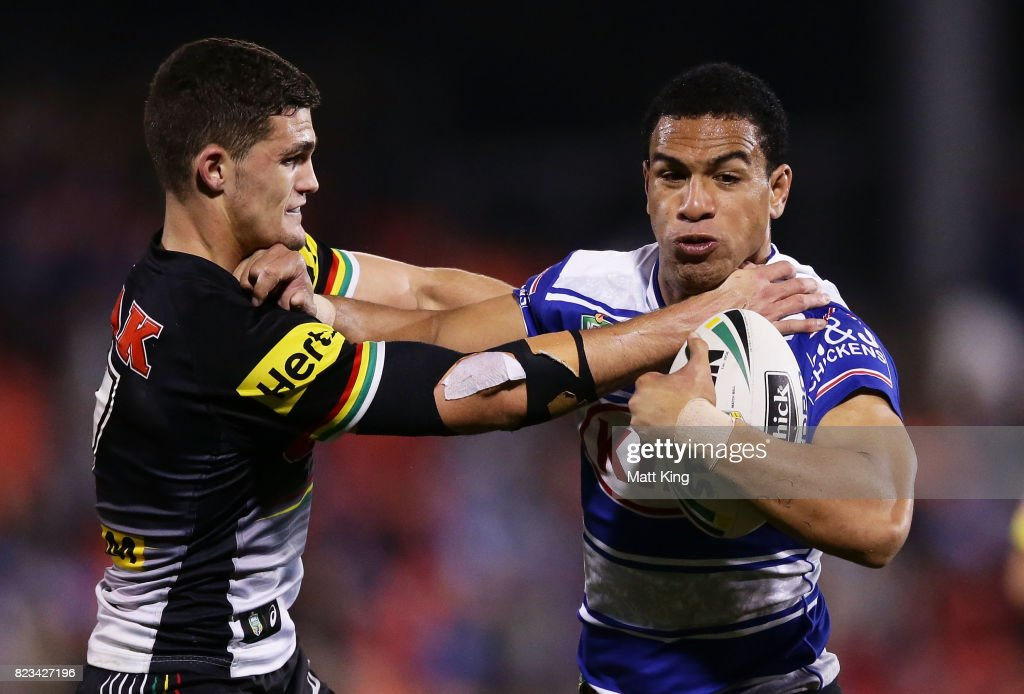 Will Hopoate of the Bulldogs puts a fend on Nathan Cleary of the Panthers during the round 21 NRL match between the Penrith Panthers and the Canterbury Bulldogs at Pepper Stadium on July 27, 2017 in Sydney, Australia.