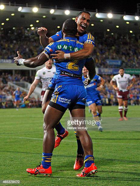 Will Hopoate of the Eels celebrates with try scorer Semi Radradra during the round one NRL match between the Parramatta Eels and the Manly Sea Eagles...