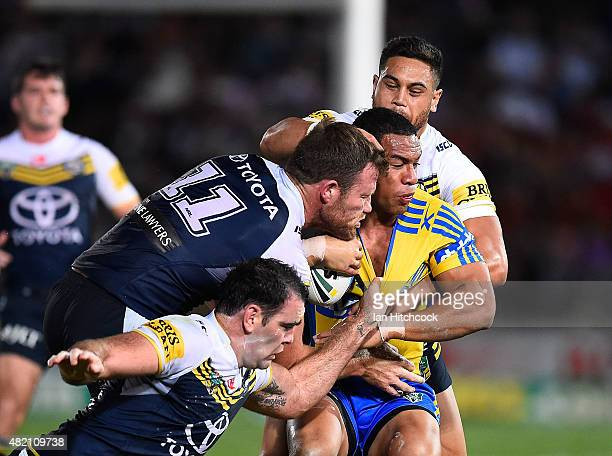 Will Hopoate of the Eels is tackled by Gavin Cooper Kane Linnett and Antonio Winterstein of the Cowboys during the round 20 NRL match between the...