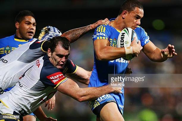 Will Hopoate of the Eels is tackled during the round 13 NRL match between the Parramatta Eels and the North Queensland Cowboys at Pirtek Stadium on...