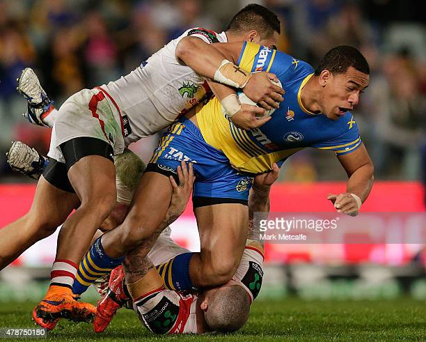 Will Hopoate of the Eels is tackled during the round 16 NRL match between the Parramatta Eels and the St George Illawarra Dragons at Pirtek Stadium...