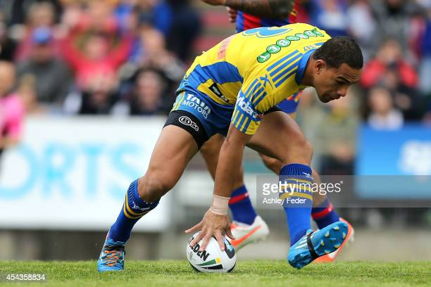 Will Hopoate of the Eels scores a try during the round 25 NRL match between the Newcastle Knights and the Parramatta Eels at Hunter Stadium on August...