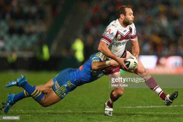 Will Hopoate of the Eels tackles Brett Stewart of the Sea Eagles during the round 24 NRL match between the Parramatta Eels and the Manly Sea Eagles...