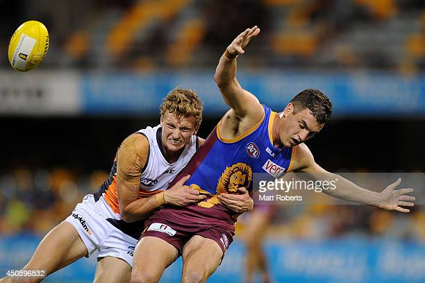 Will HoskinElliott of the Giants tackles Tom Rockliff of the Lions during the round 13 AFL match between the Brisbane Lions and the Greater Western...