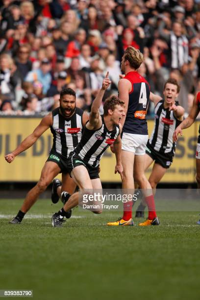 Will HoskinElliott of the Magpies celebrates a goal during the round 23 AFL match between the Collingwood Magpies and the Melbourne Demons at...
