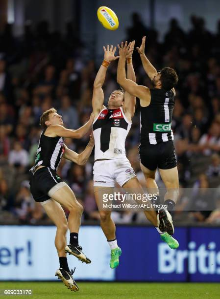 Will HoskinElliott of the Magpies Maverick Weller of the Saints and Alex Fasolo of the Magpies compete for the ball during the 2017 AFL round 04...