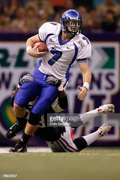 Will Hudgens of the Memphis University Tigers is sacked by Robert St Clair of the Florida Atlantic University Owls in the New Orleans Bowl on...
