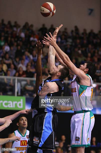 Will Hudson of the Breakers and Todd Blanchfield of the Crocodiles stretch for the ball during the round three NBL match between the New Zealand...