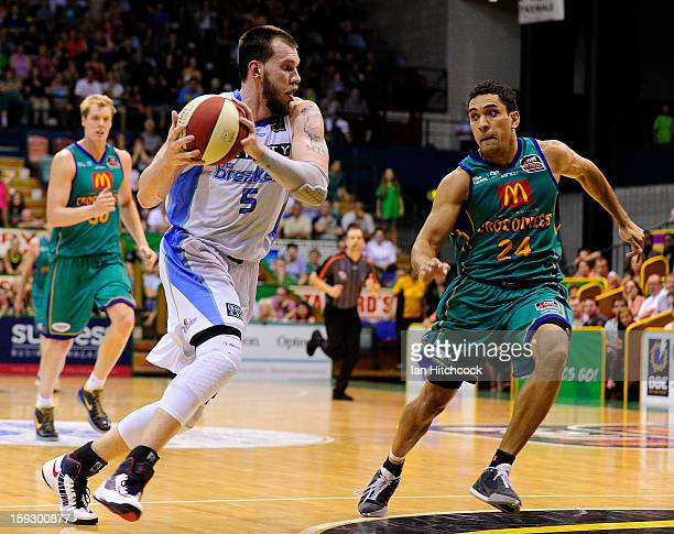Will Hudson of the Breakers drives to the basket past Michael Cedar of the Crocodiles during the round 14 NBL match between the Townsville Crocodiles...