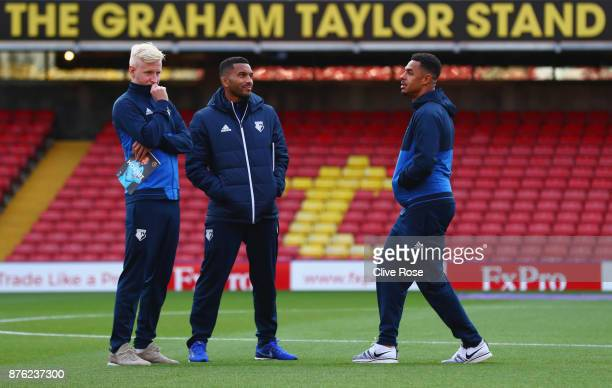 Will Hughes Adrian Mariappa and Andre Gray of Watford in discussion on the pitch prior to the Premier League match between Watford and West Ham...