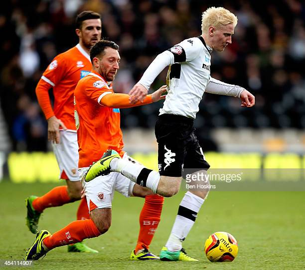 Will Hughes of Derby abvances under pressure from Stephen Dobbie of Blackpool during the Sky Bet Championship match between Derby County and...