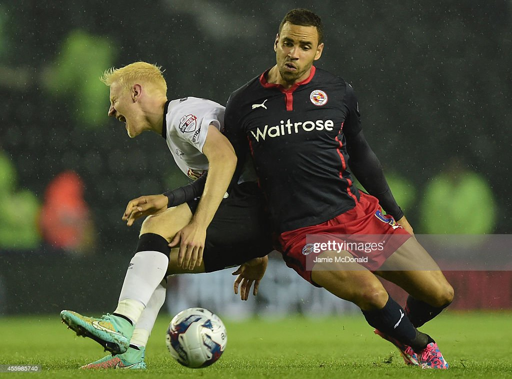 Will Hughes of Derby battles with HAl Robson-Kanu during the Capital One Cup Third Round match between Derby County and Reading at Pride Park Stadium on September 23, 2014 in Derby, England.