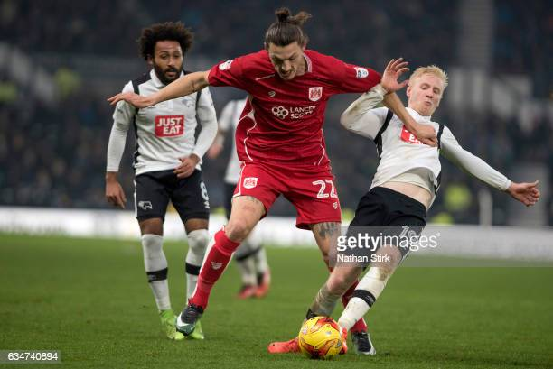Will Hughes of Derby County and Milan Djuric of Bristol City in action during the Sky Bet Championship match between Derby County and Bristol City at...