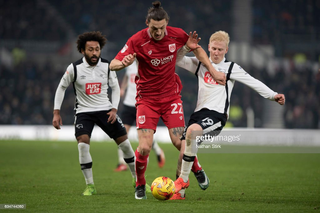 Will Hughes of Derby County and Milan Djuric of Bristol City in action during the Sky Bet Championship match between Derby County and Bristol City at the iPro Stadium on February 11, 2017 in Derby, England