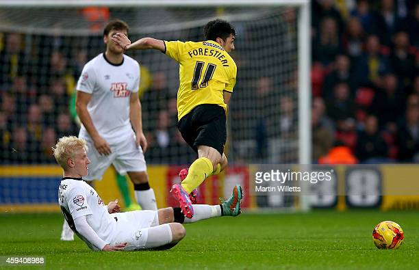 Will Hughes of Derby County slides in to tackle Fernando Forestieri of Watford during the Sky Bet Championship match between Watford and Derby County...