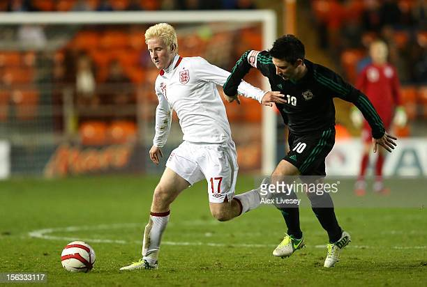 Will Hughes of England U21 holds off a challenge from Paddy McLaughlin of Northern Ireland U21 during the International Friendly Match between...