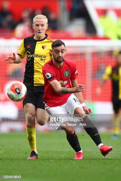 Will Hughes of Watford and Bruno Fernandes of Manchester United during the Premier League match between Manchester United and Watford FC at Old...