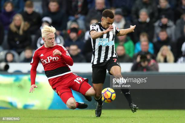 Will Hughes of Watford and Jacob Murphy of Newcastle United clash during the Premier League match between Newcastle United and Watford at St James...